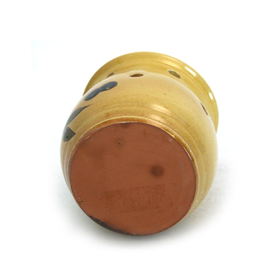 Vista inferior del pot per a alls de ceràmica
