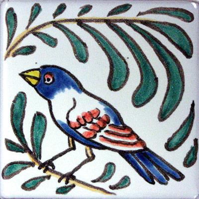 Rajoleta de ceràmica amb ocell i fulles