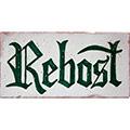 Rètol de ceràmica rústic amb 'Rebost' escrit a mà