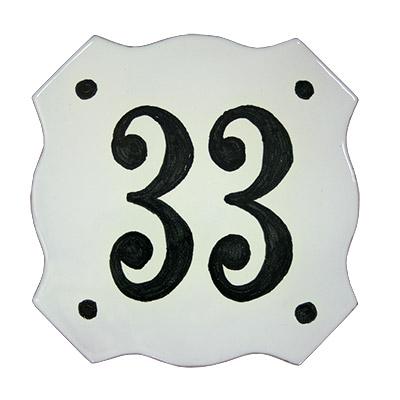 Número de paret amb forma troquelada