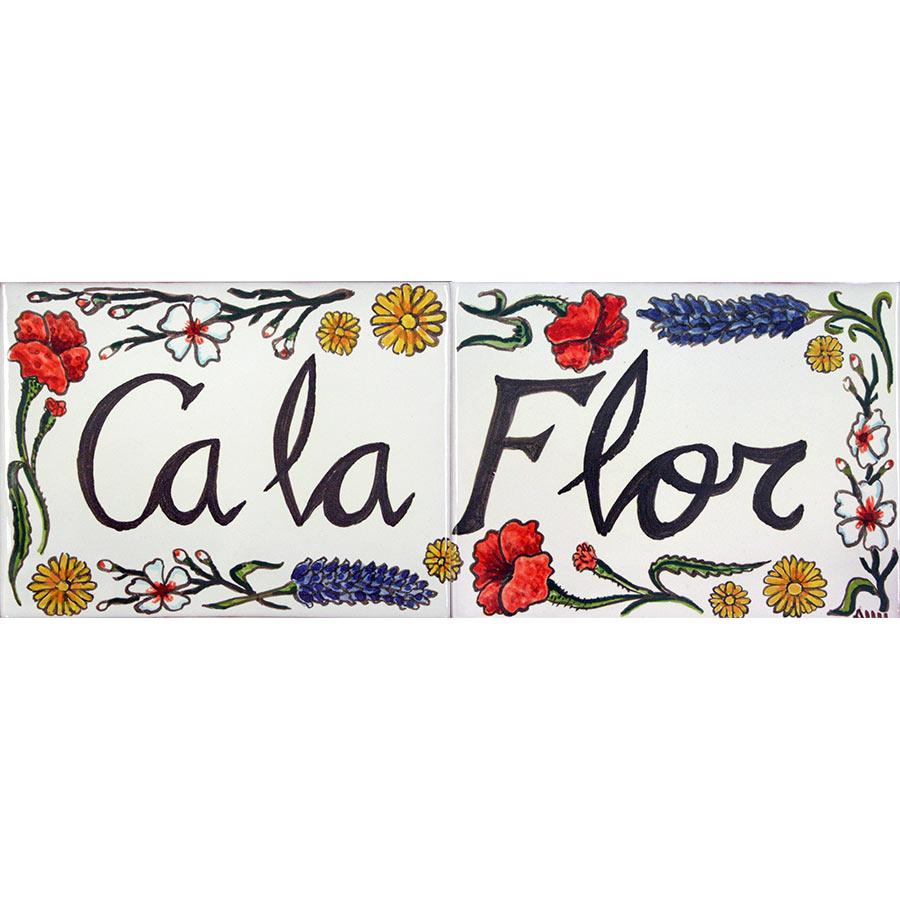 Rètol de ceràmica amb flors