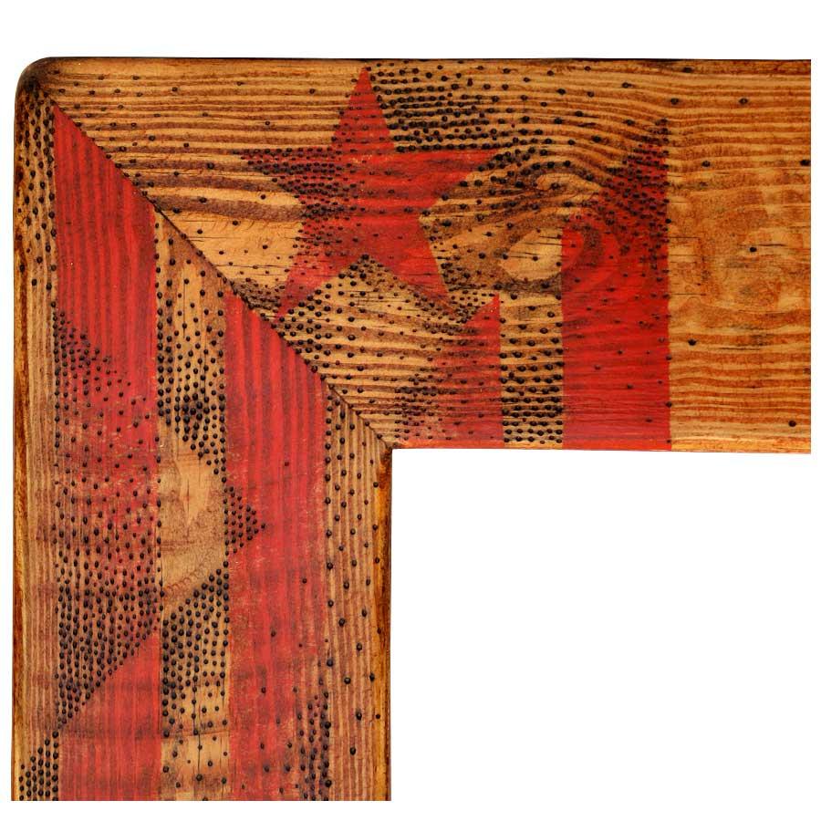 Detall de l'estelada pirogravada i pintada amb esmalt